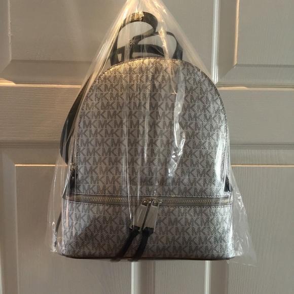 44f51451344c Michael Kors Bags | Metallic Signature Rhea Zip Backpack | Poshmark